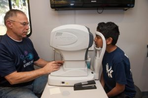 Doctor performing eye exam on patient